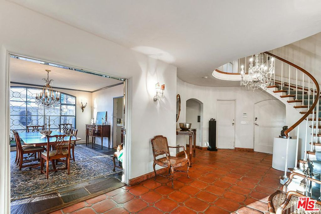Cary Grant beach house in Santa Monica for sale -Foyer stairway- own a piece of Hollywood history. The house is French Normandy style