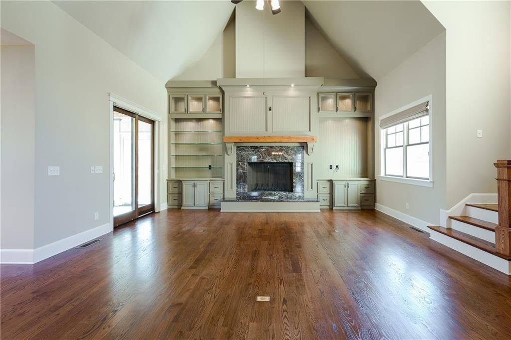 Cathredral ceiling and fireplace inside this darling Home in Atlanta GA for sale