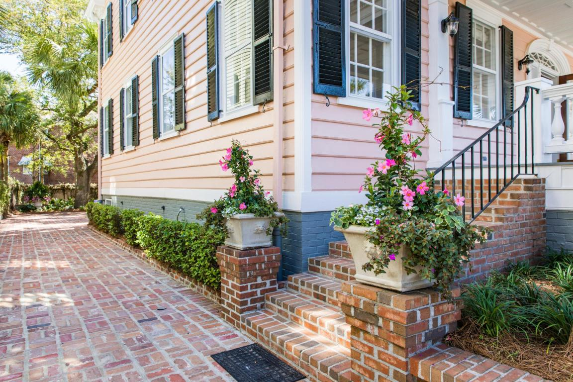 The lovely pink exterior with brick steps