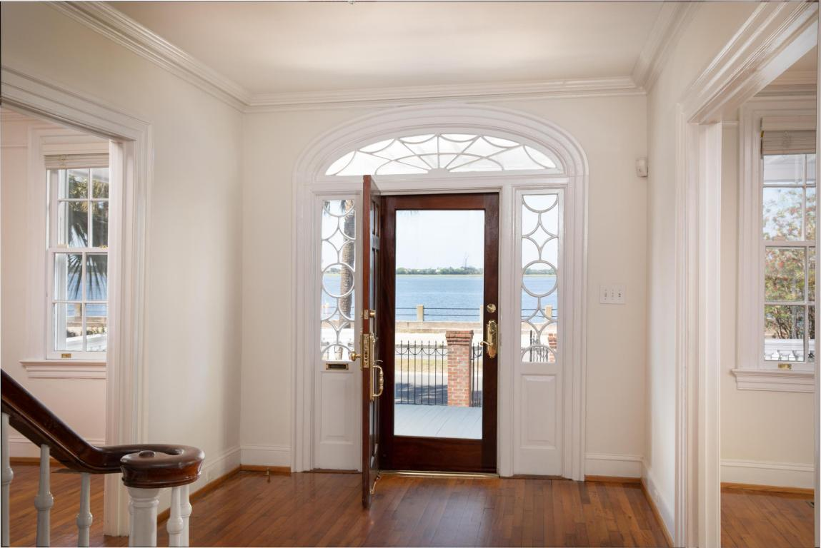 Gorgeous arched transom window over the front door