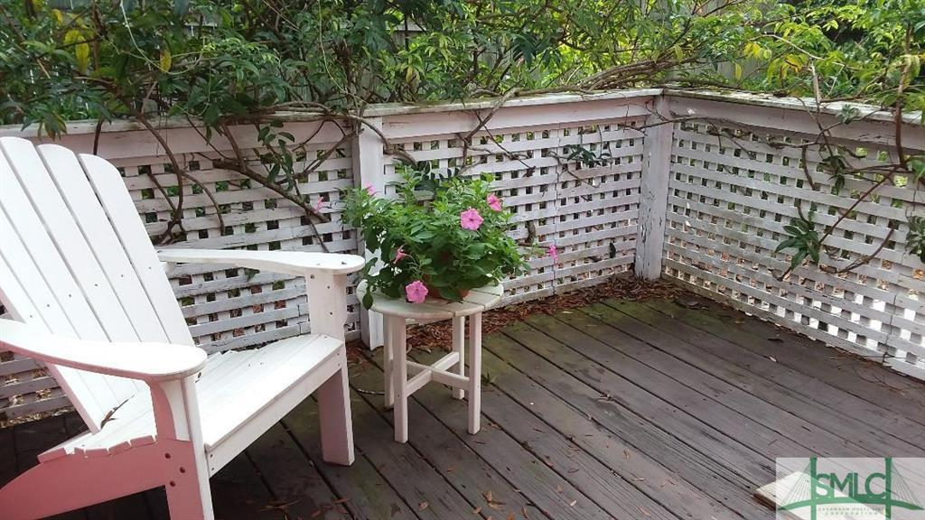 Deck with white picket fence - Castaway Cottage