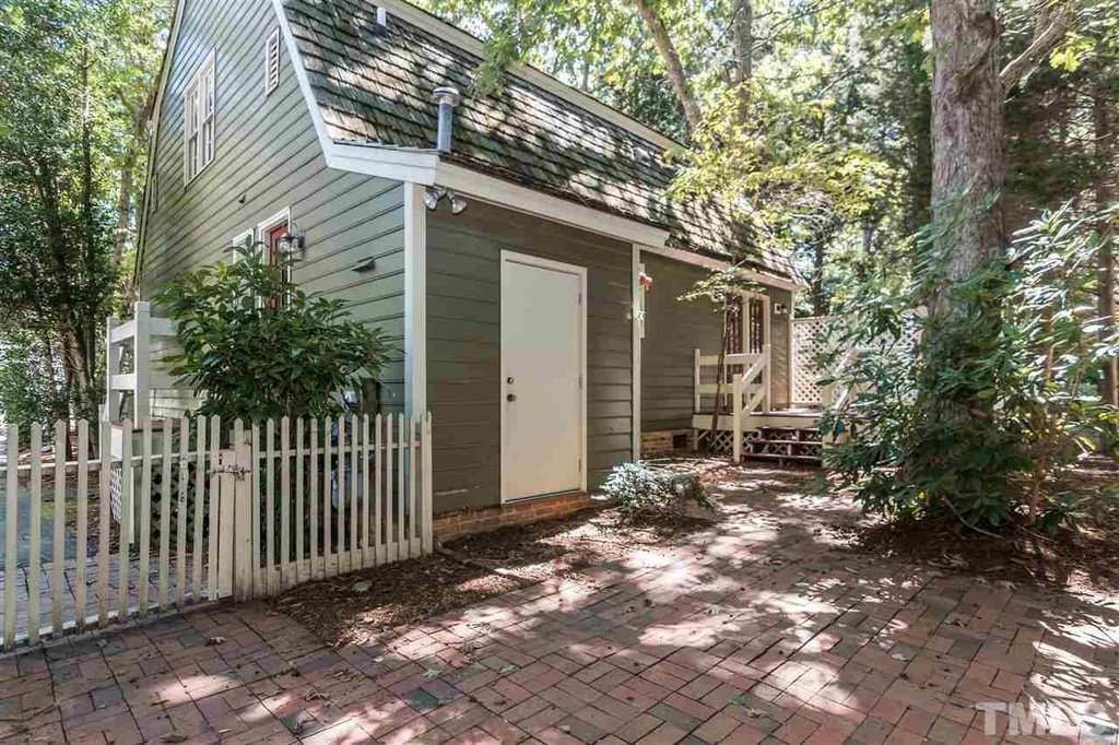 White picket fence with this cottage in Raleigh North Carolina