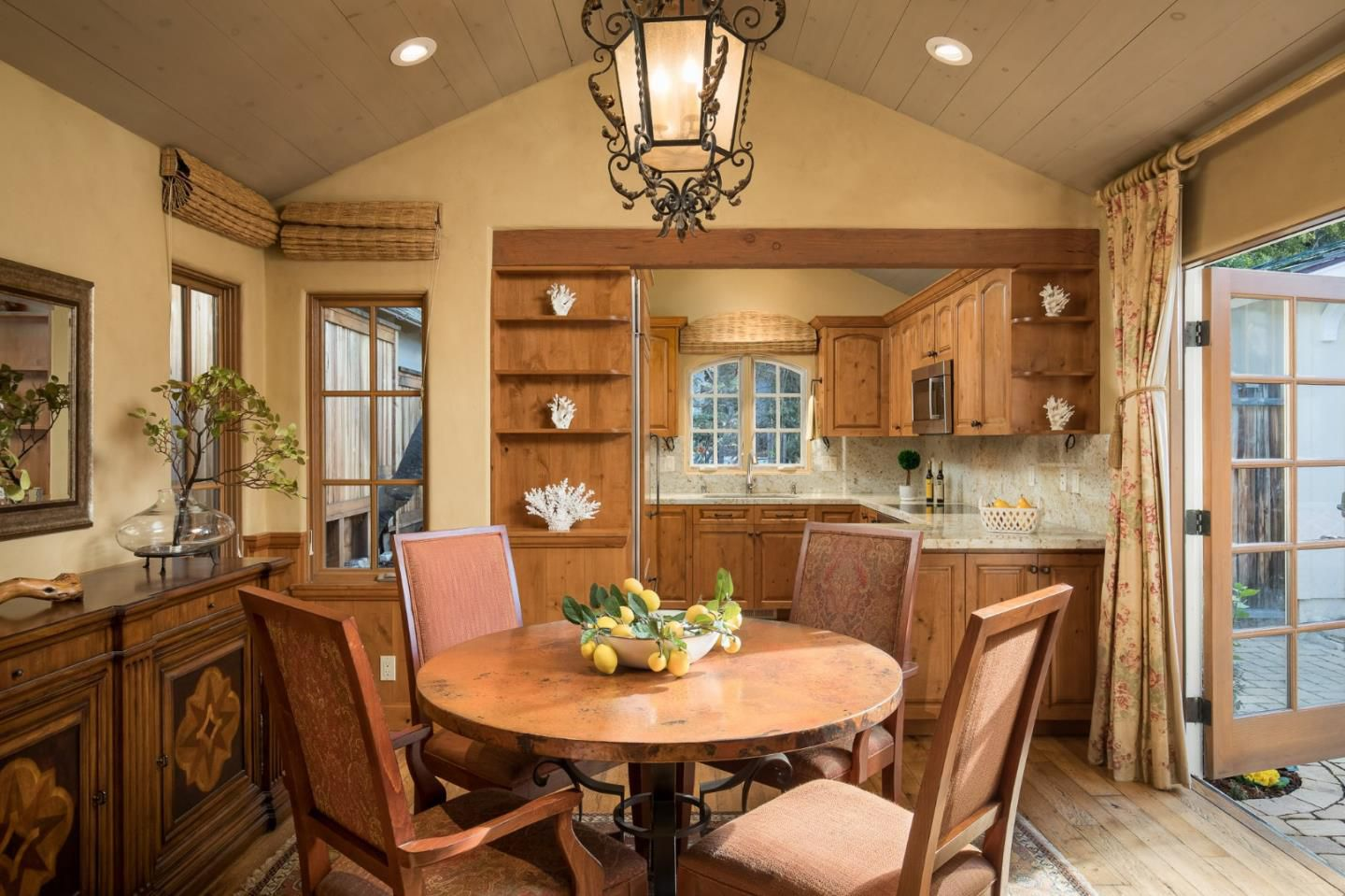 Classic Board and Batten Cottage in Carmel-by-the-Sea for sale -Dining Room with fancy lantern lighting