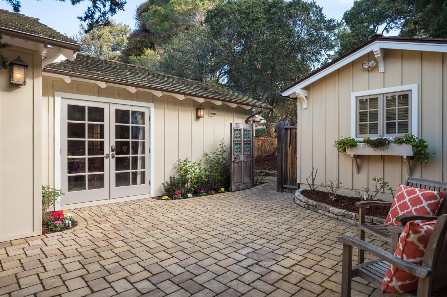 Classic Board and Batten Cottage in Carmel-by-the-Sea for sale - Enter through the elegant gateway doors to the open patio