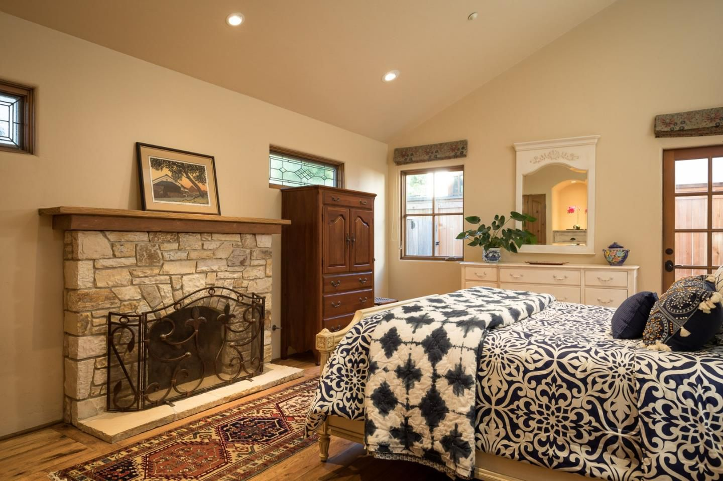 Classic Board and Batten Cottage in Carmel-by-the-Sea for sale -Small Master bedroom with fireplace