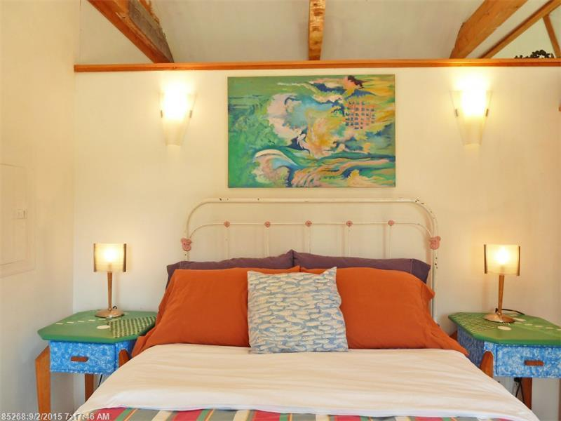 Coloreful bedroom inside shingle style cottage for sale in Maine