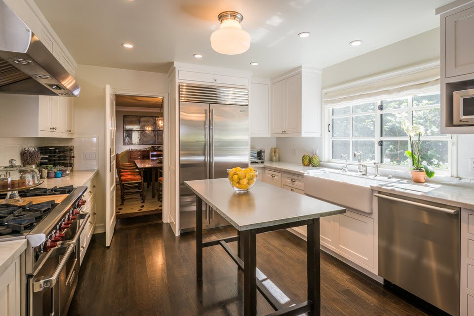 Cooks kitchen with Carrera marble and stainless steel appliances