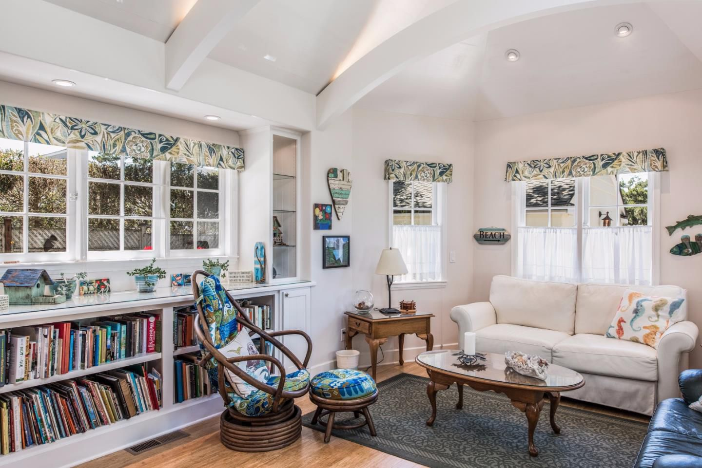 Cottage style family room with built-in bookcase