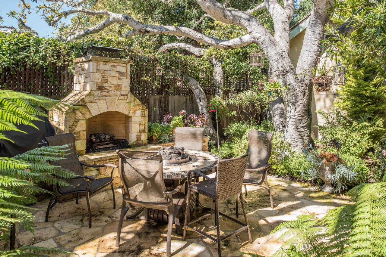 Cozy patio with table and outdoor fireplace at the Cottage in Carmel for sale that won HGTV Ultima House Hunt for Large space living in a small home