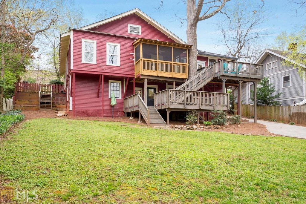 Craftsman Bungalow in Atlanta GA for sale. Rear view of house shows two decks and screened-in porch
