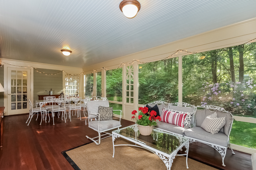 Craftsman Colonial for sale in CT has this awesome Sun Porch with custom window design
