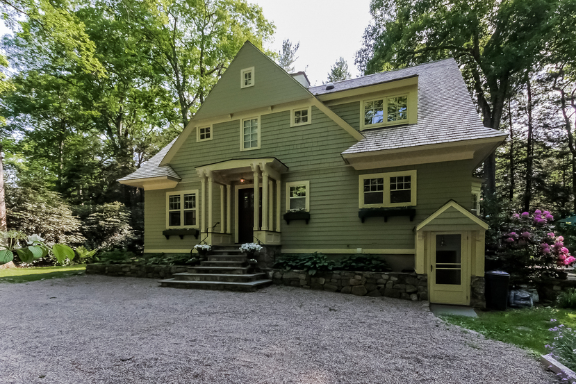 Craftsman Colonial for sale in Connecticut sits on a wonderful wooded lot