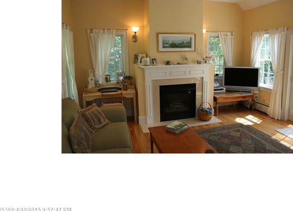 Cape Cod in Blue Hill Maine - WOODEN FLOORS, WARM YELLOW WALLS AND LOVELY FIREPLACE MAKES THIS A RELAXING ROOM.