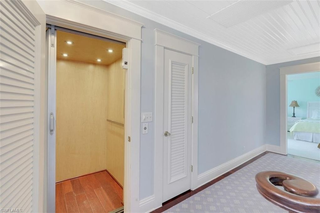 Elevator in Pink Cottage and main house for sale in Naples FL