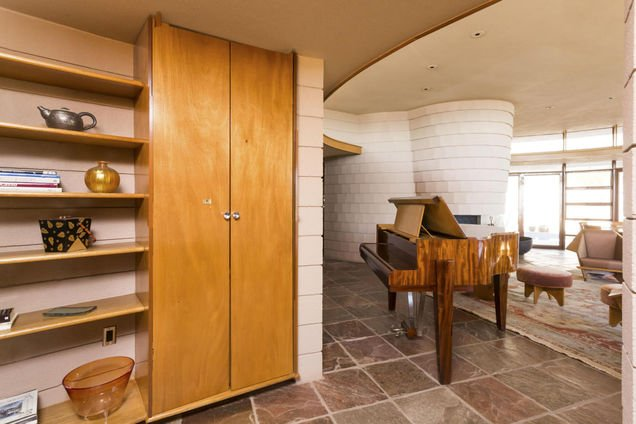 Enterrainment area - Frank Lloyd Wright house in AZ for sale has a lot of built-ins like this bar with hidden doors that close 2