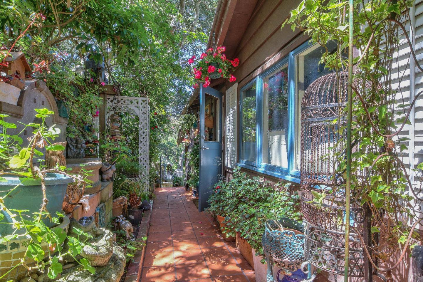 Charming sidewalk to entrance door cottage for sale in Carmel CA