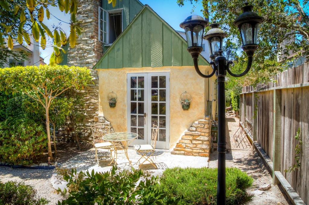 Exterior of Comstock Fairytale Cottage in Carmel for sale melts my heart. This is the kind of cottage I wish for on a star.