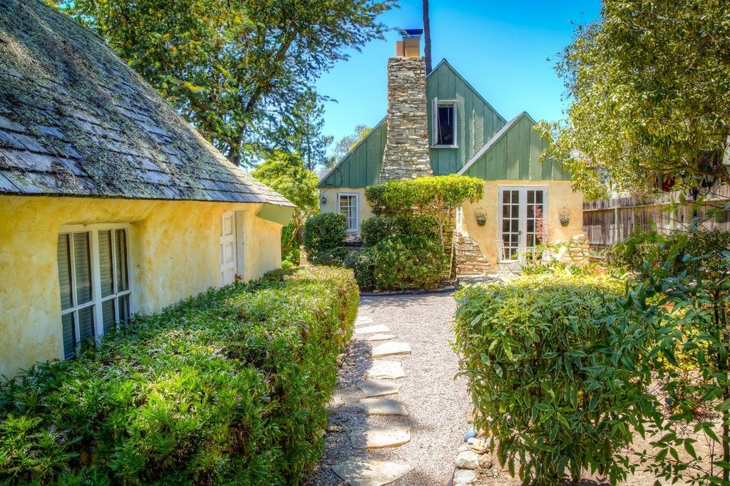 Exterior of Comstock Fairytale Cottage in Carmel for sale melts my heart. This is the kind of house I wish for on a star.