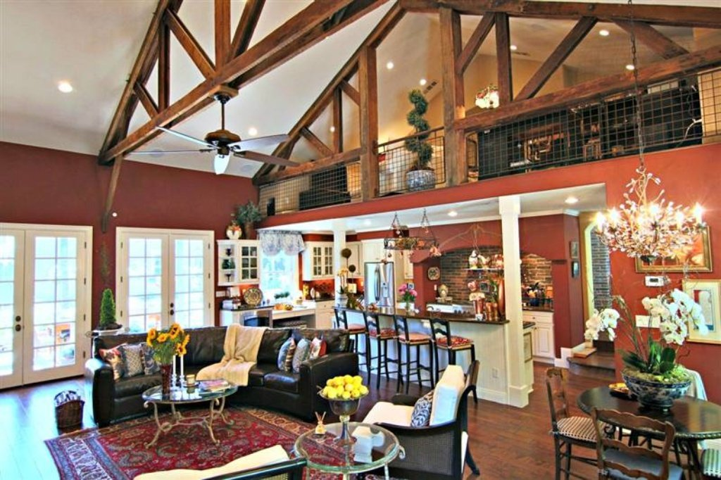 Family room open to kitchen with loft above - Sacramento, CA home recently sold. Beautiful grounds, patio, pool. Inside is stunning.