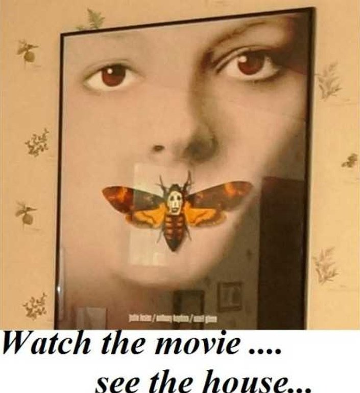Framed Silence of the Lamb poster on the wall of one of the bedrooms inside the real movie house