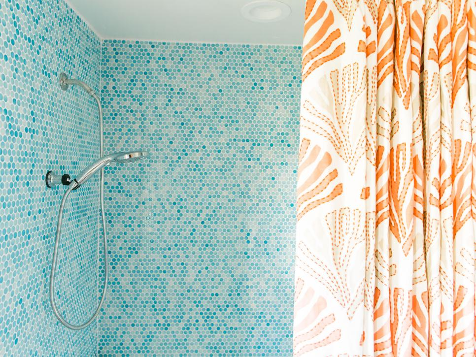 Guest bath shower with turquoise, white and blue-gray penny tile