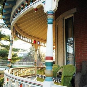 Historic Victorian for sale in Indiana with colorful front porch