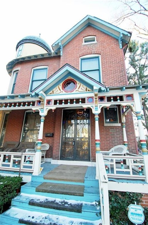 Historic Victorian for sale in Indianapolis with colorful wraparound porch