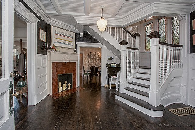 Historical Queen Anne home in Glen Ellyn IL for sale has original coal fireplace, stunning staircase