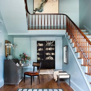 Honeymoon mansion foyer is painted ina blue-gray shade to give is a serene feeling.
