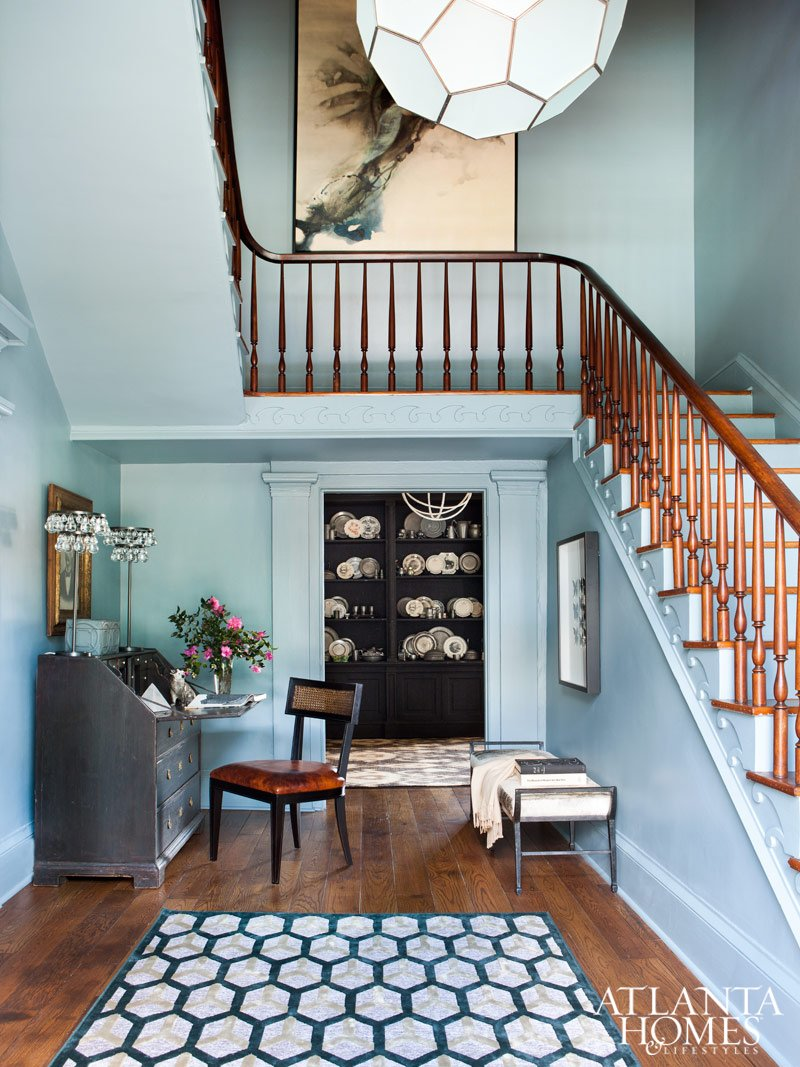 Honeymoon mansion foyer is painted a serene blue-gray