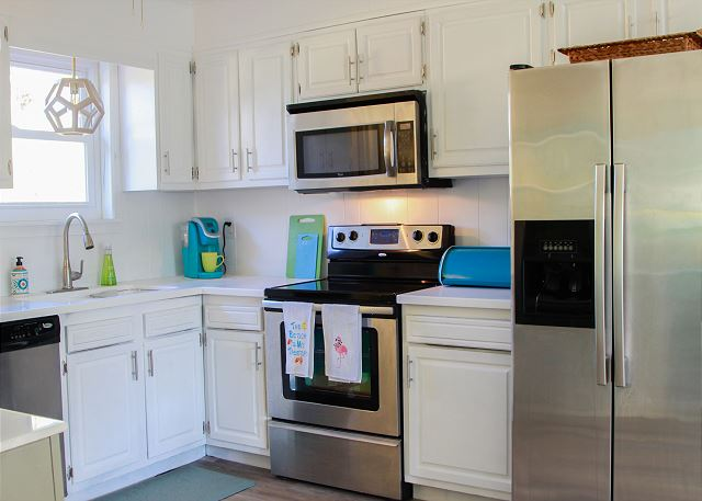 Coastal Joy Cottage Kitchen with stainless steel appliance- Tybee Island Mermaid Cottages
