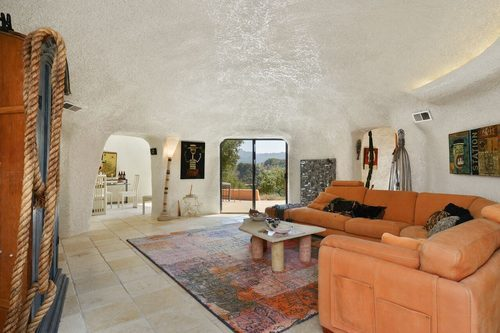 Iconic Flintstone House for sale is at 45 Berryessa Way Hillsborough CA - living room - curbed sf