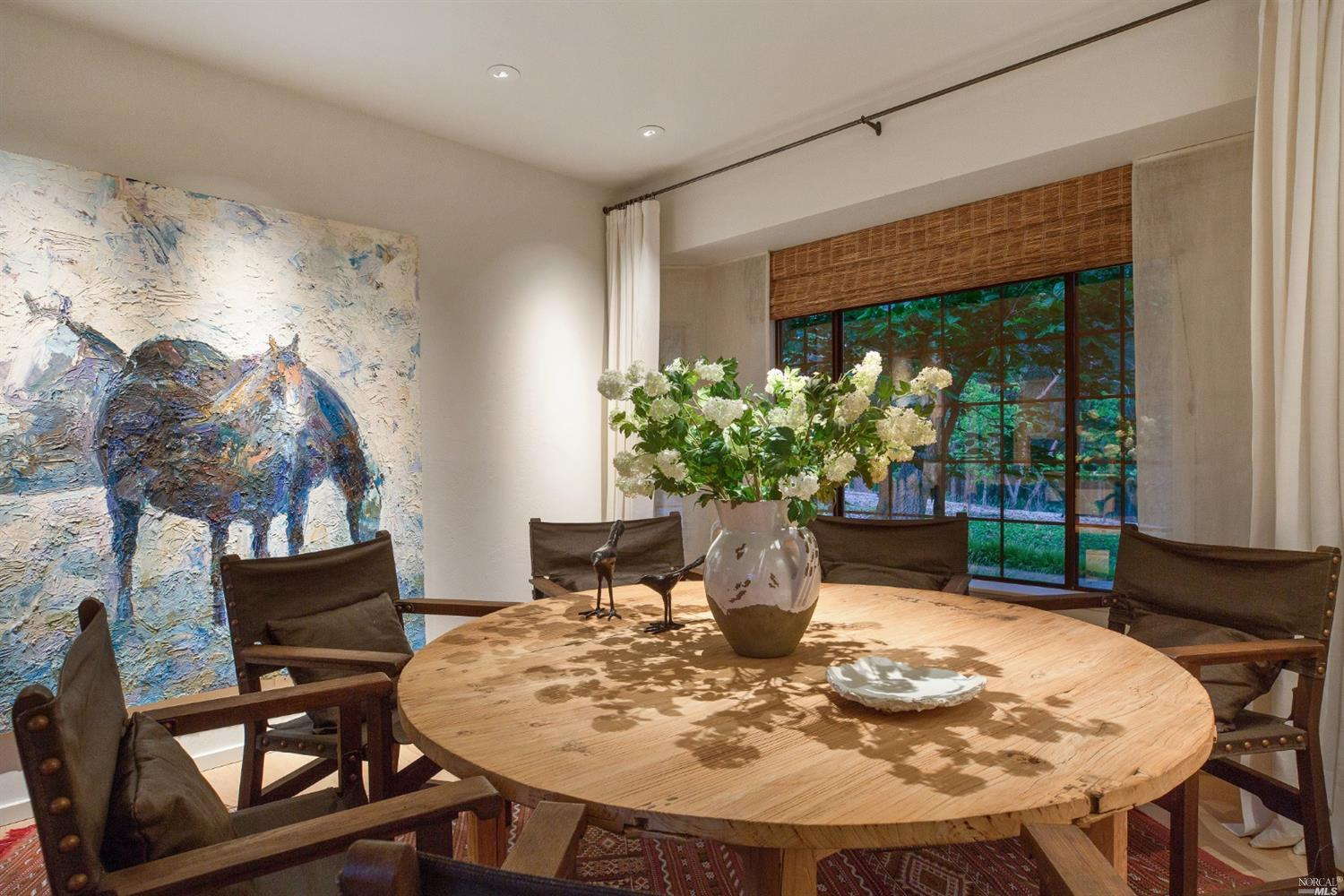 Inside Robert Redford's house for sale in St. Helene - Dining Room with beautiful round dining table