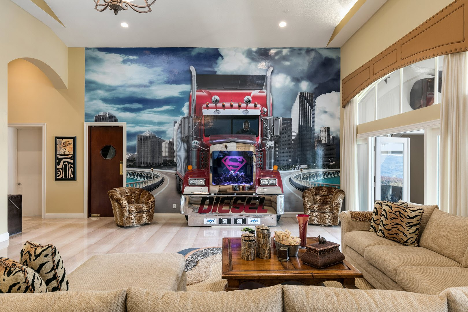 Inside Shaquille ONeal Gradious Mansion in Florida For Sale - Wall mural of a true-to-size tractor trailer barreling toward the interior of the room