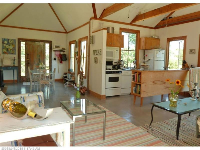 Kitchen And Open Floor Plan Inside Tiny 790 Squre Foot Shingled Cottage For Sale In Maine