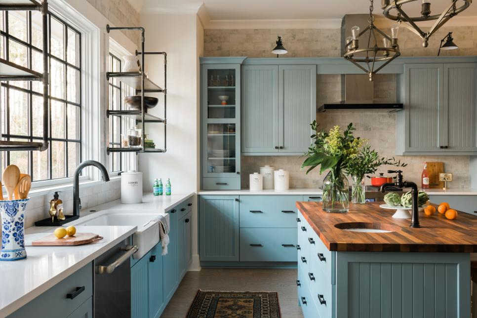 Kitchen in the HGTV Smart Home 2018 has these beautiful wall of windows above the sink and industrial see-through shelves.