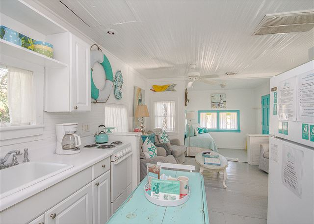 Kitchen to living room view in old love cottage on tybee island.