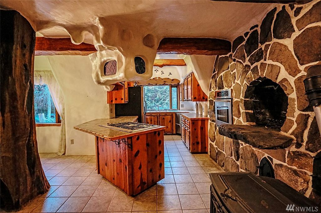Kitchen with fairytale hearth oven in Snow White's cottage in Olalla WA for sale. You can own a fairytale