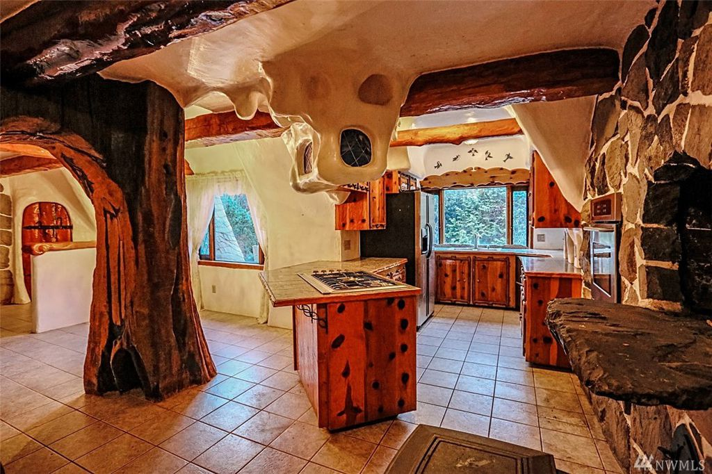 Kitchen with storybook details in Snow White's cottage in Olalla WA for sale. You can own a fairytale