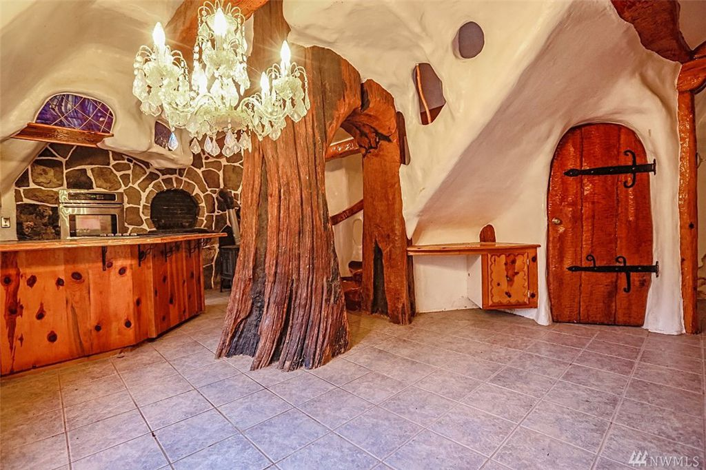 Kitchen with storybook fireplace in Snow White's cottage in Olalla WA for sale. You can own a fairytale