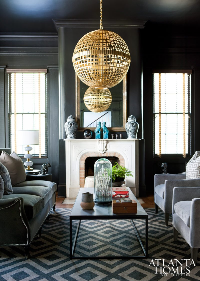 Living room Library with golden gilted orb pendant