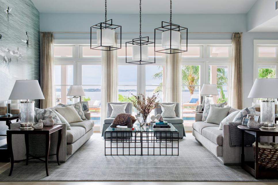 Living room, sofa, lamps and windows in the HGTV Dream Home of 2016 creates the most calming blissful atmosphere. The paint color is a soft blue-grey.