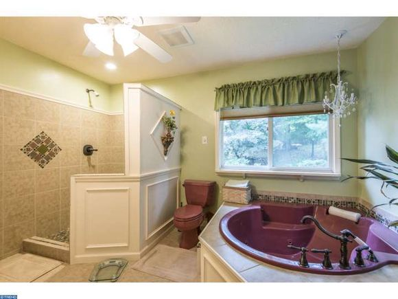 Master bath with circle tub and walk in shower in this West Chester PA home - estately