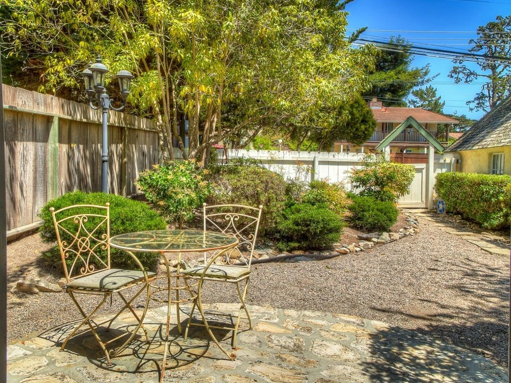 Meander up the stone path to your home in this Comstack Fairytale Cottage in Carmel California