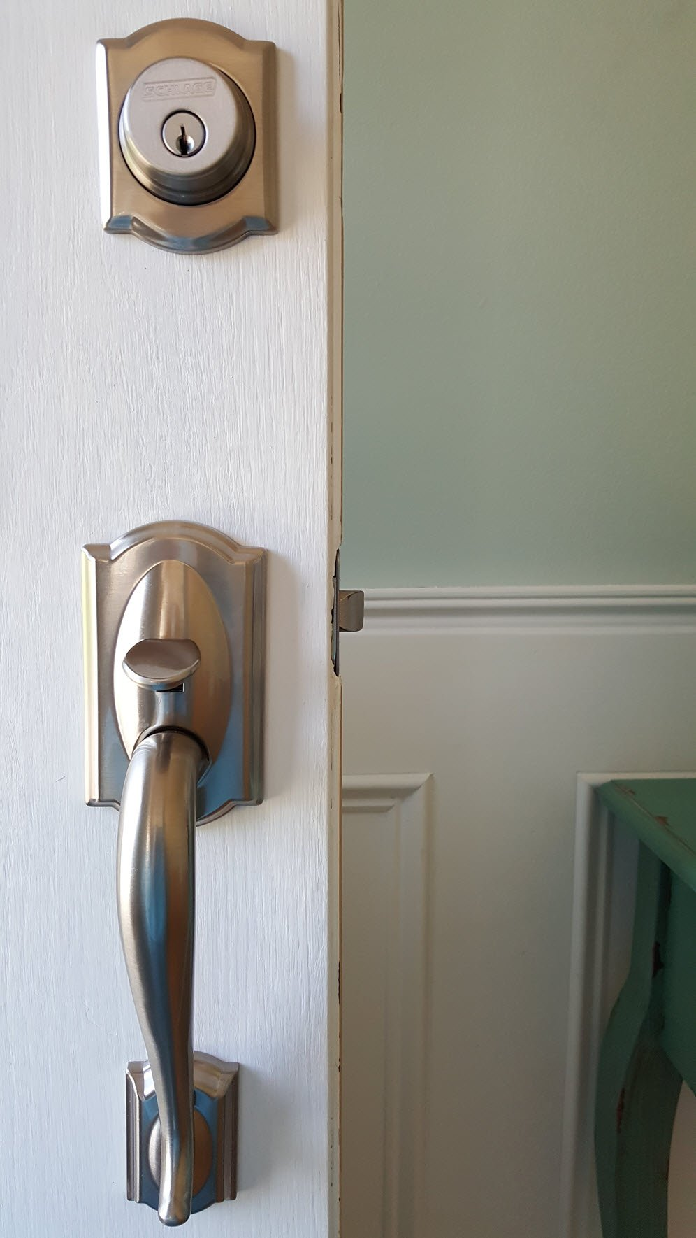 Our new door hardware dressed up the door beautifully and is a quick and easy home improvement - Housekaboodle