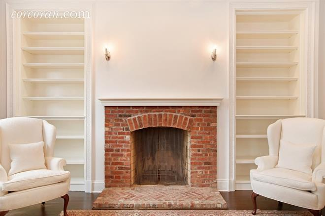 Brick fireplace in living room in NYC Cottage Penthouse