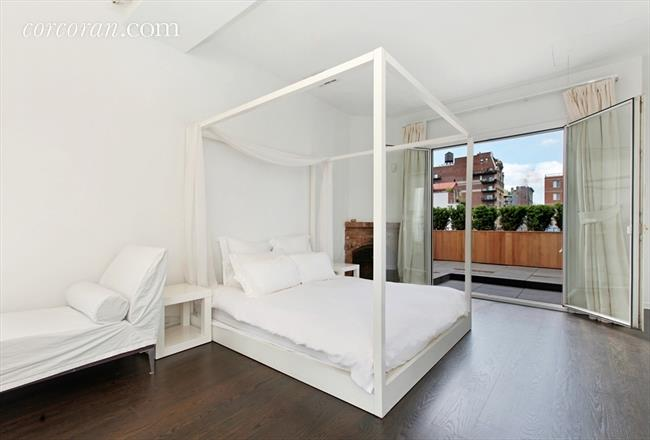 Master bedroom is high atop a Condo in NYC Cottage Penthouse