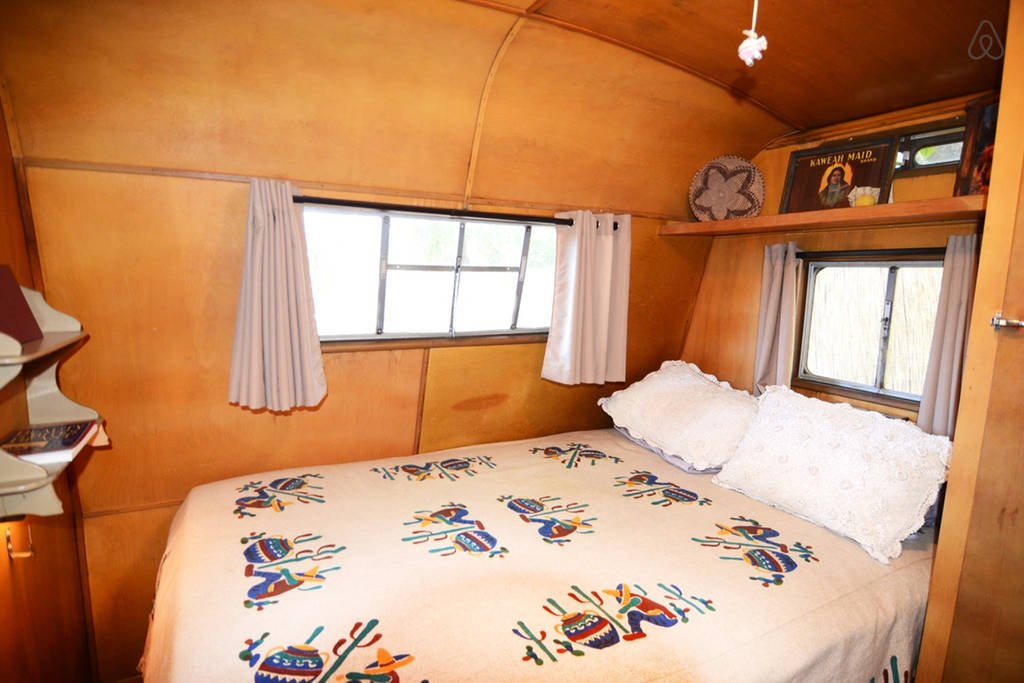 Nellie a 1954 Prarie Schooner Camper. Bedroom is decorated in vintage Mexican cowboy
