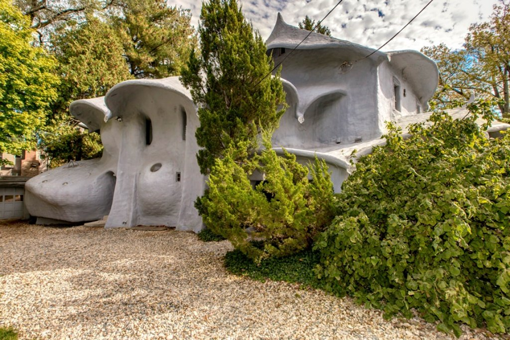Now off the market, this Flintstones type house in Maryland recently sold. The exterior gets its odd shape from polyurethane foam coating.