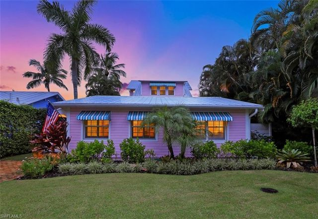 Old Florida Flamingo Style Cottage in Naples FL For sale.